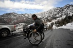 Vijay Viswanathan, 24, pulls a wheely on Camp Bird Road in Ouray, Colo., after a day of climbing in the Ouray Ice Park at the second annual Gimps on Ice on Saturday, March 13, 2010.