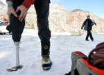 Chad Jukes attaches his crampon prosthesis at the Ouray Ice Park in Ouray, Colo., on Feb. 10, 2010.