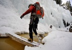 Chad Jukes balances his way across the foot bridge over the trickling Uncompahgre River in Ouray, Colo., Feb. 17, 2010.
