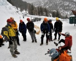 Chad Jukes explains how he climbs ice with a prosthetic leg to a group of climbers at the Ouray Ice Park in Ouray, Colo., on Feb. 19, 2010.