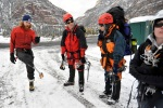 Chad Jukes explains his prosthetic ice climbing limb to climbers at the Ouray Ice Park in Ouray, Colo., Feb. 10, 2010.